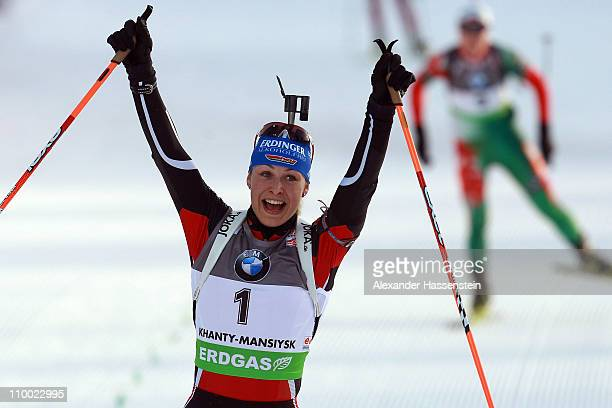 Magdalena Neuner of Germany celebrates winning the women's mass start during the IBU Biathlon World Championships at A.V. Philipenko winter sports...