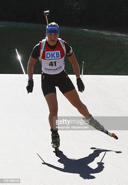 Magdalena Neuner of Germany competes in the women's 15 km individual event during the German Championships at the Chiemgau Arena on September 16,...