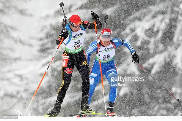 Magdalena Neuner of Germany competes infront of Olga Zaitseva of Russia during the Women's 75 km Sprint in the IBU Biathlon World Cup on December 11...