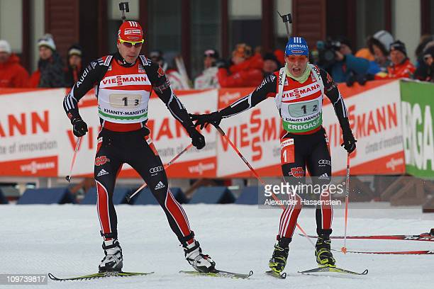 Magdalena Neuner of Germany hands over to her team mate Arnd Pfeiffer at the mixed relay during the IBU Biathlon World Championships at AV Philipenko...