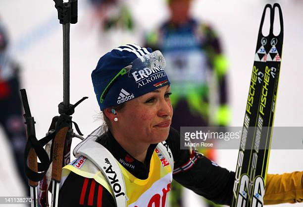 Magdalena Neuner of Germany looks dejected after the Women's 125km Mass Start during the IBU Biathlon World Championships at Chiemgau Arena on March...
