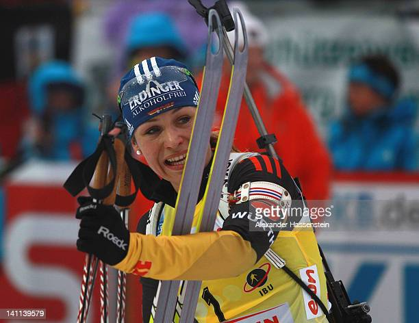Magdalena Neuner of Germany looks on at the finish area after the Women's 125km Mass Start during the IBU Biathlon World Championships at Chiemgau...