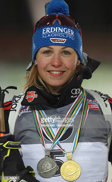 Magdalena Neuner of Germany poses with her gold medal for the women's 75km sprint and her silver medal won at the mixed relay during the IBU Biathlon...