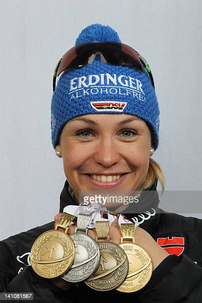 Magdalena Neuner of Germany shows her medals of the Women's 4 x 6km Relay during the IBU Biathlon World Championships at Chiemgau Arena on March 10,...