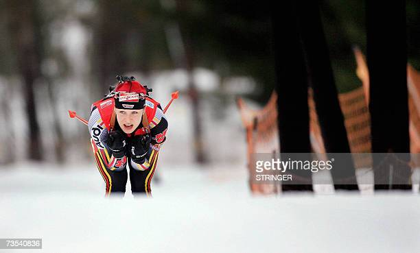 Magdalena Neuner of Germany skis during the 10 kms pursuit IBU World Cup biathlon event in Holmenkollen near Oslo 10 March 2007. Neuner took the...