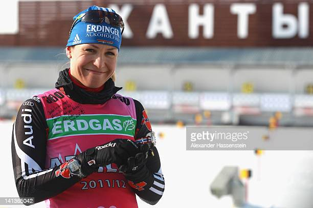 Magdalena Neuner of Germany smiles at a private note attached to her bib from her team mate Miriam Goessner during training session for the IBU Wolrd...