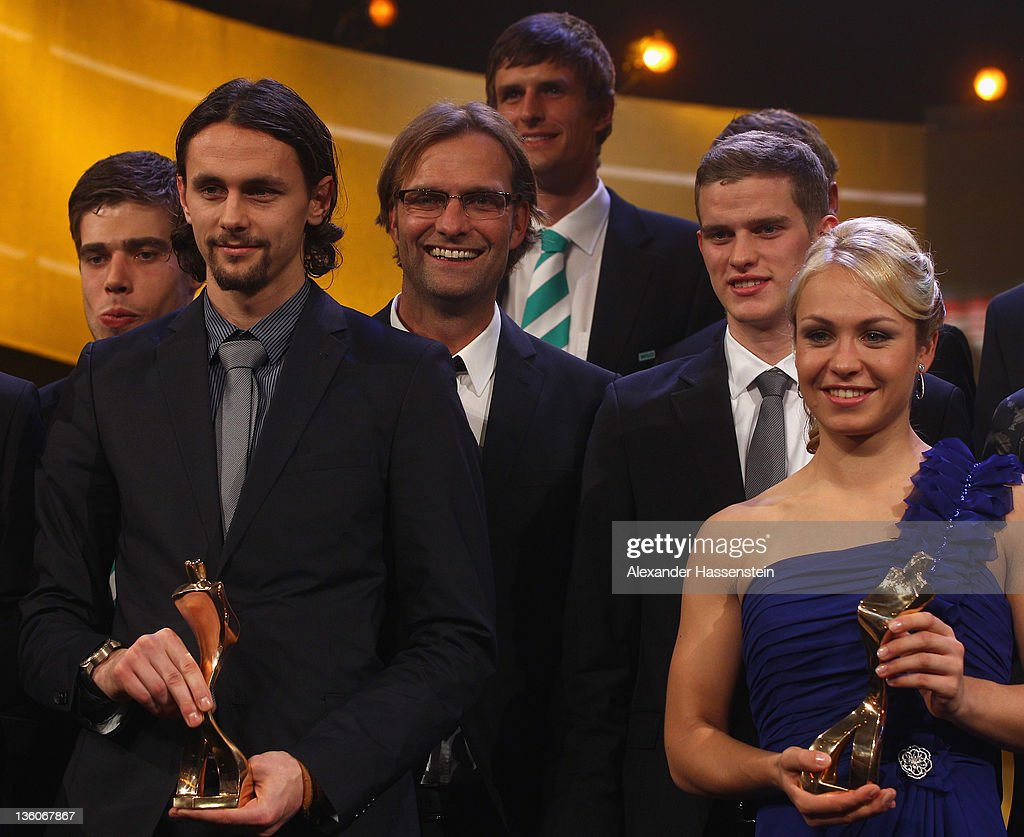 Magdalena Neuner (R) poses with Juergen Klopp (C), head coach of Borussia Dortmund and his players Sven Bender (R) and Neven Subotic (2nd L) and their 'Athlete of the Year 2011' award during the 'Athlete of the Year 2011' gala at the Kurhaus Baden-Baden on December 18, 2011 in Baden-Baden, Germany.