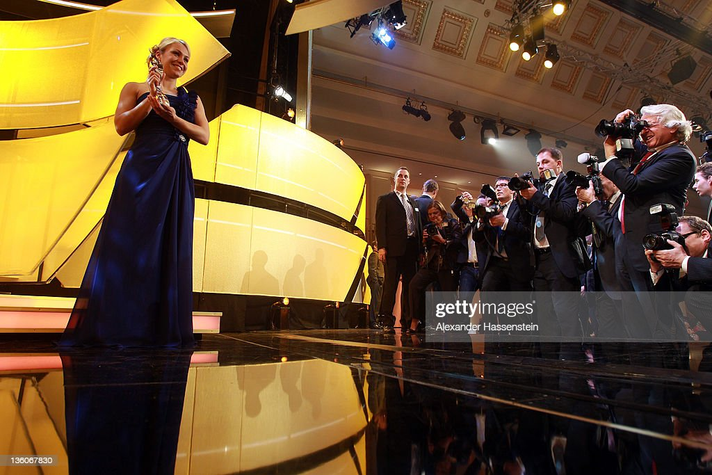 Magdalena Neuner poses with the female 'Athlete of the Year 2011' award during the 'Athlete of the Year 2011' gala at the Kurhaus Baden-Baden on December 18, 2011 in Baden-Baden, Germany.