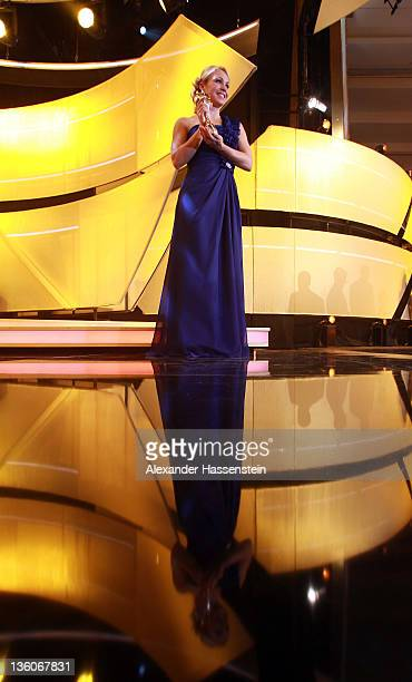 Magdalena Neuner poses with the female 'Athlete of the Year 2011' award during the 'Athlete of the Year 2011' gala at the Kurhaus Baden-Baden on...