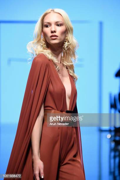 Magdalena Przybielska walks the runway wearing Michael Costello at Los Angeles Fashion Week Powered by Art Hearts Fashion LAFW SS/19 at The Majestic...