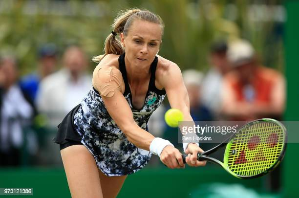 Magdalena Rybarikova of Slovakia hits a backhand during her second round match against Mona Barthel of Germany on Day Five of the Nature Valley Open...