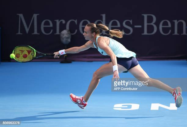 Magdalena Rybarikova of Slovakia hits a return during her women's singles match against Simona Halep of Romania at the China Open tennis tournament...