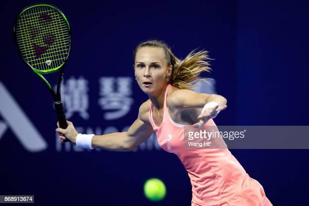 Magdalena Rybarikova of Slovakia hits a return in her match against Kristina Mladenovic of France during the WTA Elite Trophy Zhuhai 2017 at Hengqin...