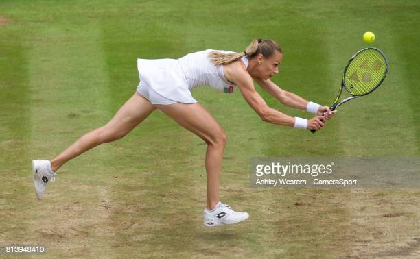 Magdalena Rybarikova of Slovakia in action during her defeat by Garbine Muguruza of Spain in their Ladies' Singles Semi Final Match at Wimbledon on...