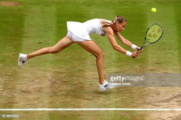 Magdalena Rybarikova of Slovakia plays a backhand during the Ladies Singles semi final match against Garbine Muguruza of Spain on day ten of the...
