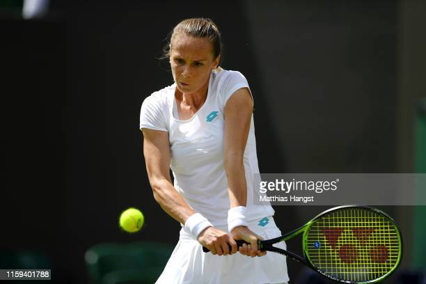 Magdalena Rybarikova of Slovakia plays a backhand in her Ladies' Singles first round match against Aryna Sabalenka of Belarus during Day one of The...