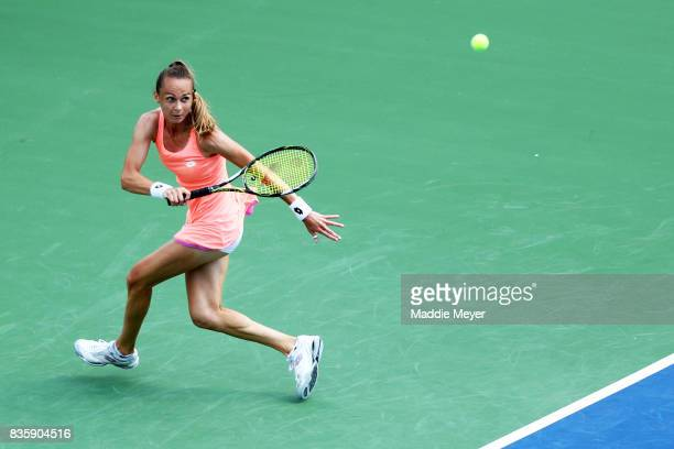 Magdalena Rybarikova of Slovakia returns a shot to to Kirsten Flipkens of Belgium during Day 3 of the Connecticut Open at Connecticut Tennis Center...