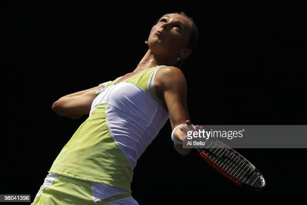 Magdalena Rybarikova of Slovakia serves against Marion Bartoli of France during day three of the 2010 Sony Ericsson Open at Crandon Park Tennis...