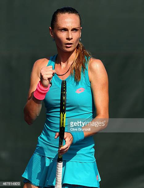Magdalena Rybarkova of Slovakia celebrates a point against Alison Van Uytvanck of Belgium in their first round match during the Miami Open at Crandon...