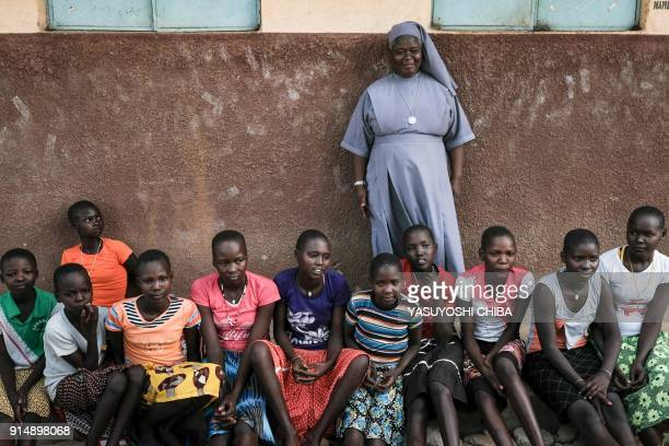 Magdalene Nantongo head teacher of Kalas Girl's primary school which hosts escaped girls from female genital mutilation and child marriage poses with...