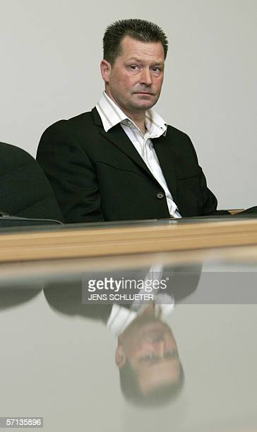 Former German athletics coach Thomas Springstein waits 20 March 2006 at court in Magdeburg where he was handed a 16month suspended jail sentence...