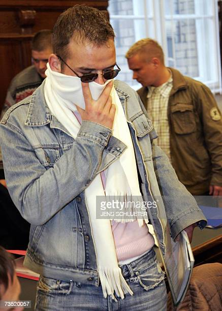 The accused Lars K arrives before the start of the trial against seven suspected rightwing extremists accused of publicly burning a copy of Anne...