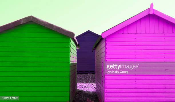 magenta and green beach huts - lyn holly coorg stock photos and pictures