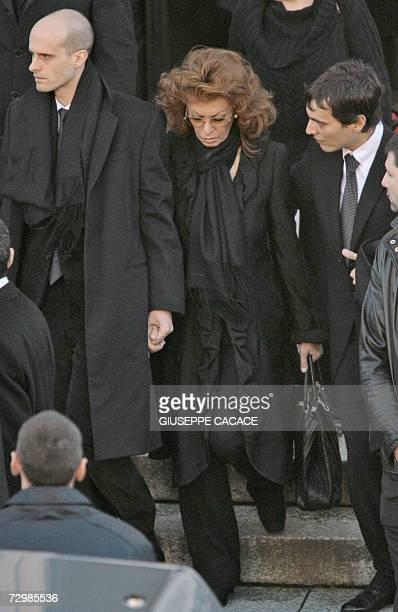 Italian actress Sophia Loren and her sons Edoardo and Carlo Jr leave the San Martin church in Magenta near Milan at the end of her husband Carlo...