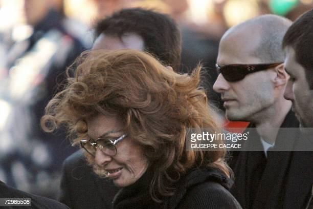 Italian actress Sophia Loren and his son Eduardo arrive at funeral of her husband Carlo Ponti at San Martin church 12 January 2007 in Magenta...