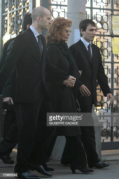 Italian actress Sophia Loren leaves with her sons Edoardo and Carlo Jr the Magenta Cemetery on 12 January 2007 in Magenta where the producer was born...