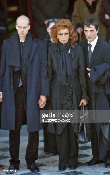 Italian actress Sophia Loren leaves with her sons Edoardo and Carlo Jr San Martin Church 12 January 2007 in Magenta Northern Italian town near Milan...
