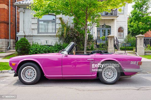 magenta triumph tr6 sports car convertible - triumph motorcycle stock pictures, royalty-free photos & images