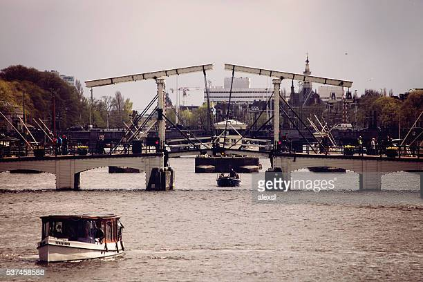 Magere skinny bridge over Amstel river in Amsterdam