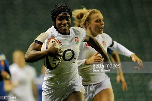 Maggie Alphonsi of England breaks through to score a try during the International match between England Women v France Women at Twickenham Stadium on...