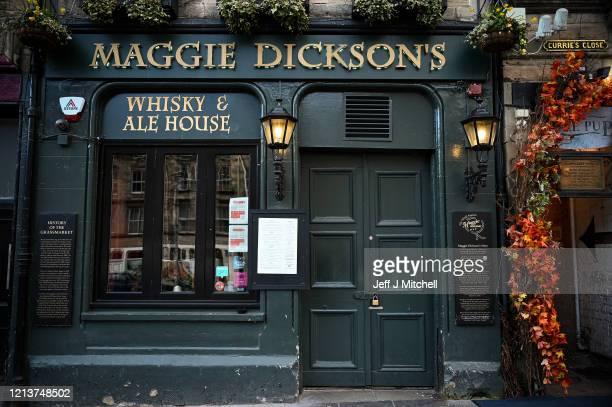 Maggie Dickson's pub in the Grassmarket closes on March 20, 2020 in Edinburgh, United Kingdom. British Prime Minister Boris Johnson announced that...
