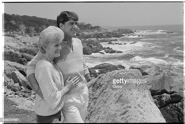 Maggie Eastwood exwife of Clint Eastwood stands on the beach with her partner Henry Wynberg
