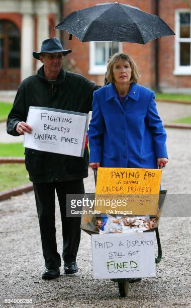 Maggie Gebbett arrives at Bromley Civic Centre in Bromley Kent with her husband Martin to pay a parking fine of 80 with a wheelbarrow full of copper...