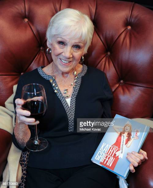 Maggie Griffin the mother of TV personality Kathy Griffin poses with a copy of her daughter's book Official Book Club Selection at the Barnes Noble...