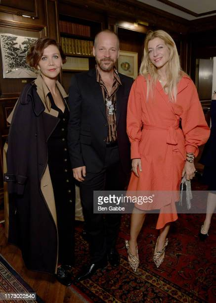 Maggie Gyllenhaal Peter Saarsgard and Ada Kokosar attend the Adeam Spring/Summer 2020 Dinner on September 07 2019 in New York City
