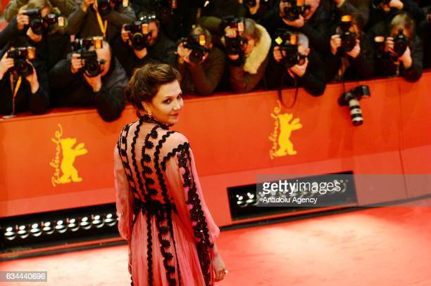 Maggie Gyllenhaal poses on the red carpet during opening ceremony of the 67th Berlinale International Film Festival at Grand Hyatt Hotel in Berlin...