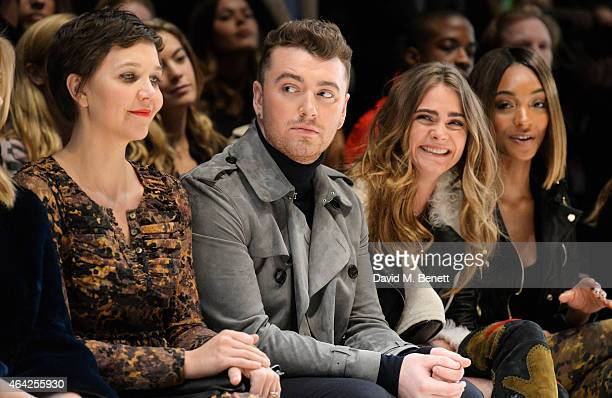 Maggie Gyllenhaal, Sam Smith, Cara Delevingne and Jourdan Dunn attend the Burberry Prorsum AW 2015 show during London Fashion Week at Kensington...