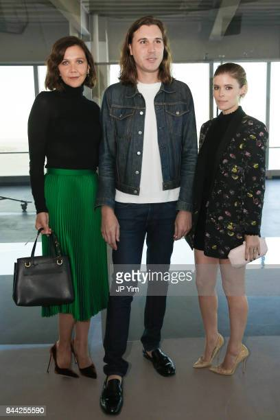 Maggie Gyllenhaal, Steve Cateron, VP of Women's Design at Club Monaco and Kate Mara attend the Club Monaco Presentation at 4 World Trade Center...