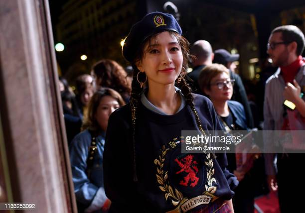 Maggie Jiang arrives at the Tommy Hilfiger TOMMYNOW Spring 2019 TommyXZendaya Premieres at Theatre des ChampsElysees on March 02 2019 in Paris France