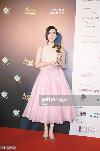 Maggie Jiang wins the Best newcomer of the 8th Asia Film Award on March 27 2014 in Macau China