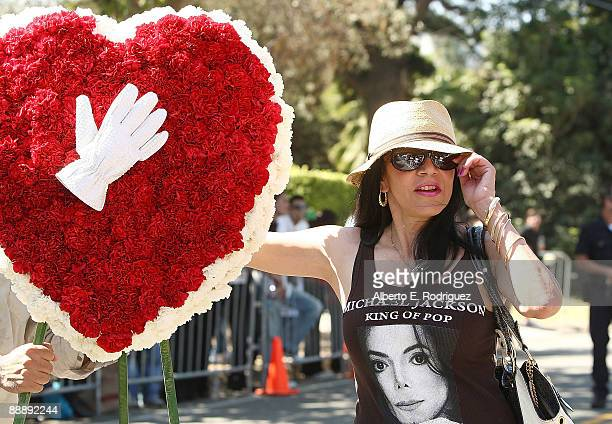 Maggie Lopez delivers a flower arrangement at the Jackson family compound after the memorial service for singer Michael Jackson on July 7 2009 in...