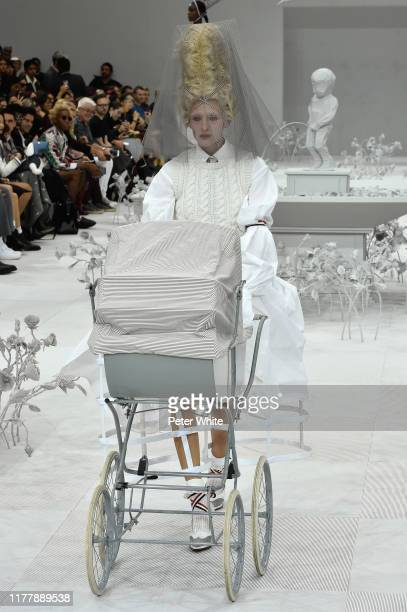 Maggie Maurer walks the runway during the Thom Browne Womenswear Spring/Summer 2020 show as part of Paris Fashion Week on September 29, 2019 in...