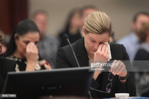 Maggie Nichols mother of victim Gina Nichols and Assistant Attorney General Angela Povilaitis wipes tears from their eyes as they listen to Gwen...