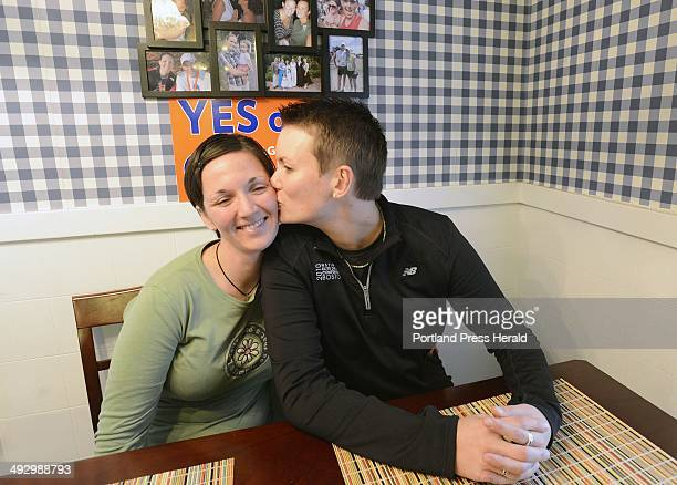 Maggie Oechslie right gives Alisson Poisson a kiss on the cheek at their home in South Portland Wednesday November 7 2012 The two had a ceremony in...
