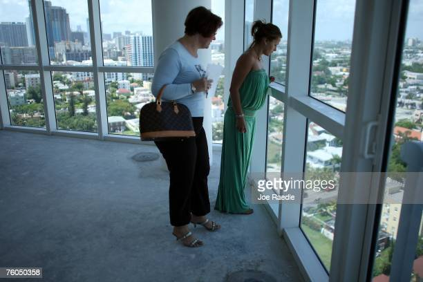 Maggie OertelAyguen a real estate agent from Kamany Realty shows Rocio Marquez around a condo for sale August 10 2007 in Miami Florida The developers...