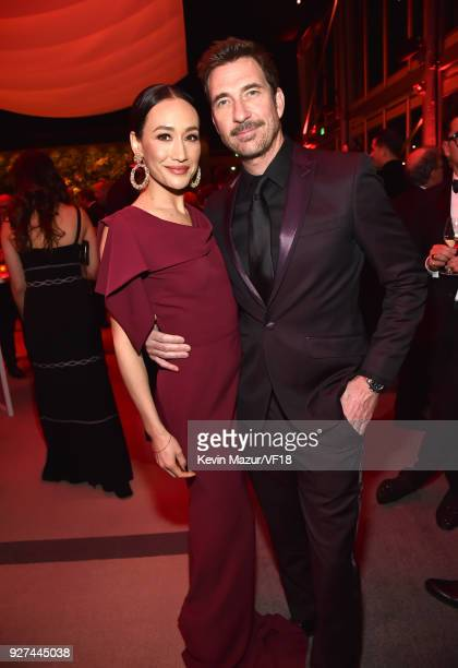 Maggie Q and Dylan McDermott attends the 2018 Vanity Fair Oscar Party hosted by Radhika Jones at Wallis Annenberg Center for the Performing Arts on...